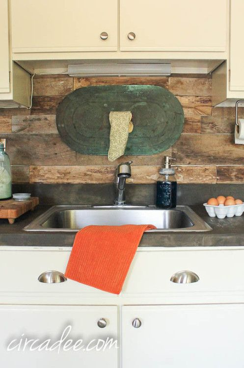 kitchen with diy pallet backsplash