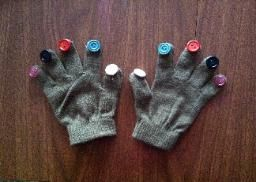 Button Gloves-This activity encourages finger isolation, thumb opposition, proprioceptive input and fun! Pinned by SOS Inc. Resources.  Follow all our boards at http://pinterest.com/sostherapy  for therapy resources.
