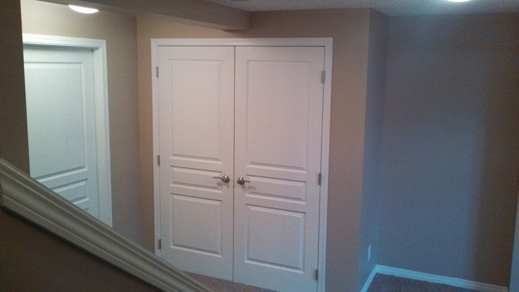 Basement landing double swing closet doors on magnet for Basement double door