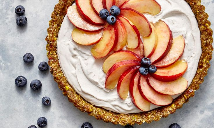 Vegan Coconut Cream Tart with White Peaches and Blueberries | This nutrient-rich twist on coconut cream pie is lusciously smooth… it's also vegan, paleo, gluten-fee, and raw. In other words, you're looking at a tart with a stacked resume. Perfect for a special occasion, especially if you're looking to clean up your diet a bit, this show-stopping vegan dessert offers rich, toasty flavor and sweet tooth satisfaction—without adding refined sugar. And since there's no need to crank up the oven to