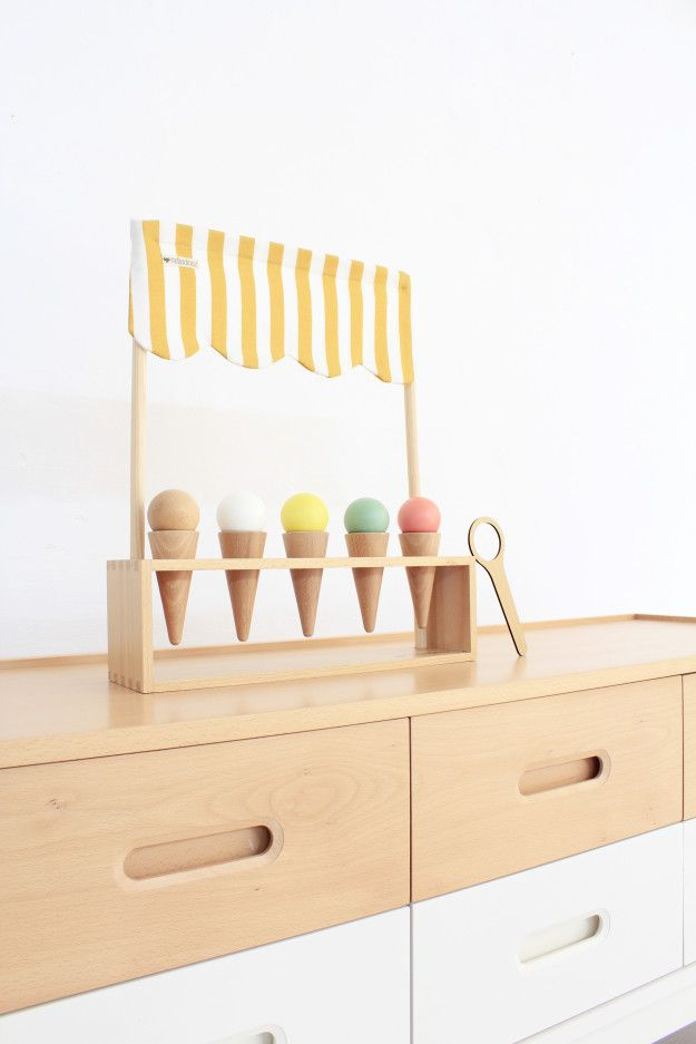 Wooden ice cream stand toy.