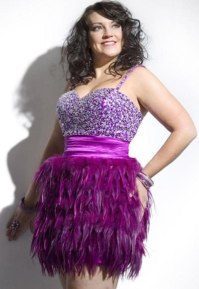 Party Time Plus Size 6955  This plus size homecoming dress features an elegantly encrusted bust with rich jewel beading that covers the sweetheart bodice and tank straps of this pretty and playful style. A lightly ruched satin waistband breaks up the bodice and the skirt of this party dress, defining the waist and adding a touch of shine. The short sheath skirt is covered in matching features for an extra playful touch that will leave onlookers envious as you enter the room in style.