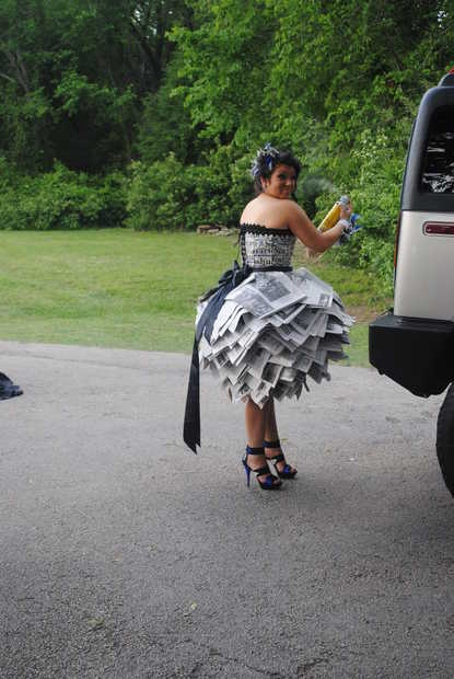 You need to be creative sometimes, and a dress out of newspaper is definitely cr