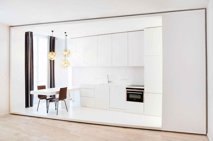 White kitchen by capo-architectes   web site: www.capo-architectes.com