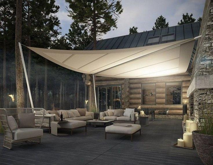 protection solaire avec un voile d'ombrage pour la terrasse dans le jardin