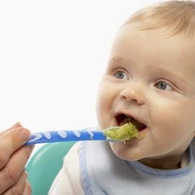 Mashed fruits like avocado make a yummy food for baby.
