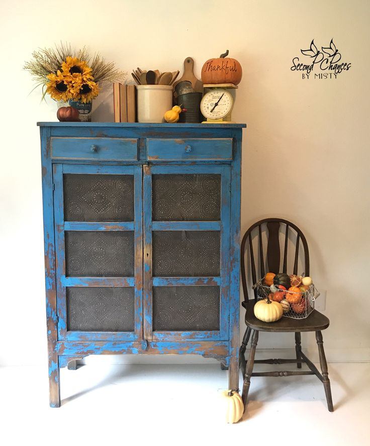 This rustic pie safe was painted in Annie Sloan's Giverny with black & dark wax. Love a great primitive cabinet!