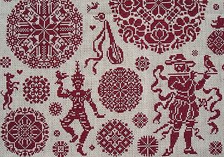 Close-up du marquoir rouge en point de croix nomé Viva la Vida Sampler de Clorami Designs