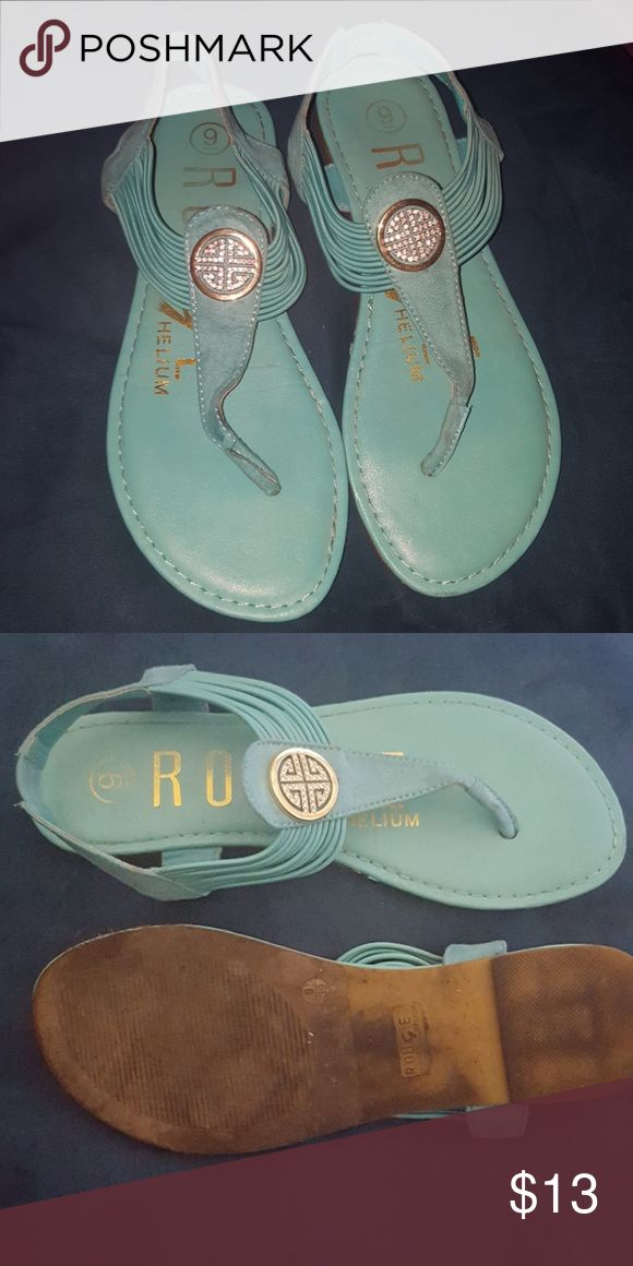 Light teal sandals Light green flip flop sandals with elastic straps. Lightly worn. Sandal charm is gold colored with rhinestones. Light teal color. Rogue Helium Shoes Sandals