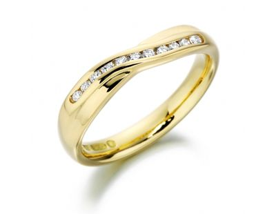 Diamond set crossover ring 18ct yellow gold court shaped crossover wedding ring set with 11 round brilliant cut diamonds. Handmade in the UK by skilled craftsmen. Finger size L. Please contact us for other finger sizes. http://www.julify.com/