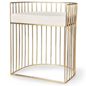 Bring a modern look with tons of shine into your home with the Metal Caged Accent Stool in Gold from Nate Berkus. This bird cage-styled metal golden stool has an upholstered seat in white.