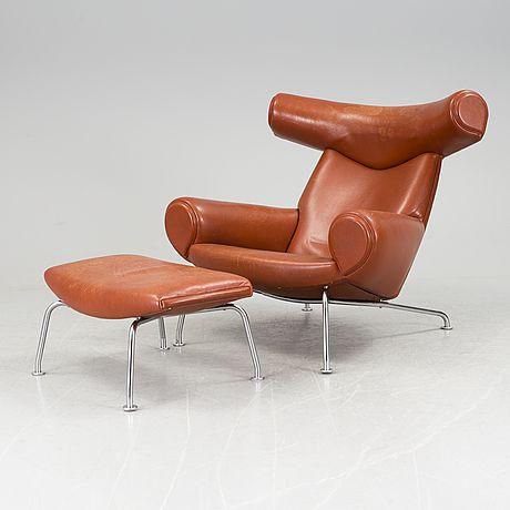 "HANS J WEGNER Fåtölj med fotpall, ""Ox-Chair"", Erik Jorgensen, Danmark."