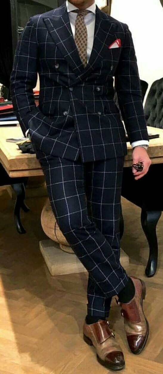 Custom double breasted navy windowpane piece w/ surgeon cuffs.