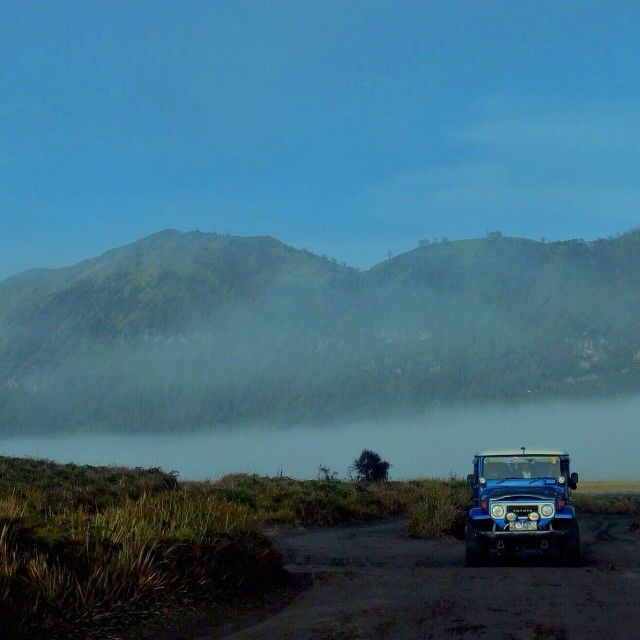 Through the misty morning in Bromo with the blue Toyota FJ 40, Bondowoso, East Java #fj #fj40 #toyota
