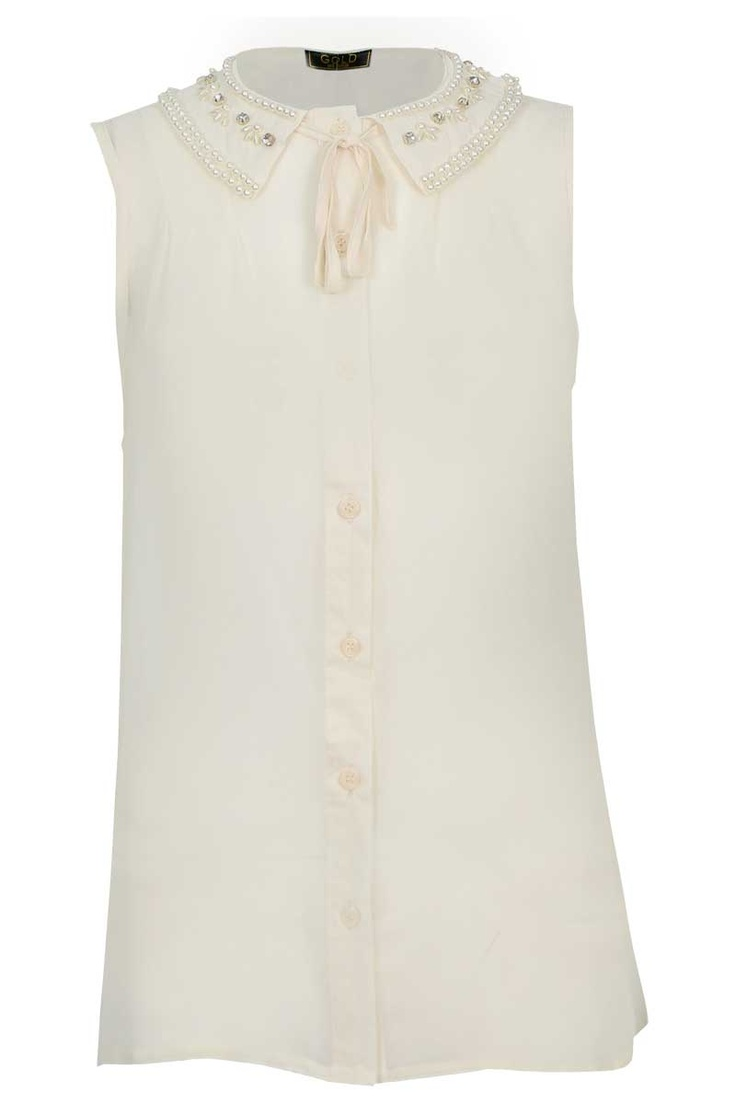 The Elsa Beaded Collar Sleeveless Blouse in Cream is one of our favourite pieces at Popcouture.co.uk for this seasons lady like trend. Priced at only £18 there are no excuses, go on, do it like a lady!