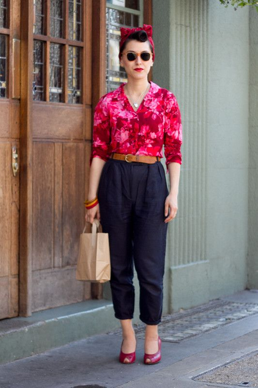 Coggles Fashion - London Street Style with red headband, cropped navy trousers, red peep toed shoes, bangles, red floral shirt, tan belt, 50's sunglasses.