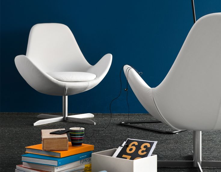 The Electa swivel chair is a modern classic.  Resting on a satin steel base the Electa is stocked in two fabrics and white leather.  Comfort and elegant design meet seemlessly. Available at POMP HOME in Culver City, CA www.pomphome.com
