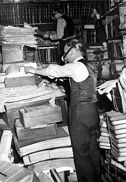 Learn the Importance of the Historical Records Survey: Historical Records Survey workers inventorying and surveying records in a sub-cellar below river level in New York City c. 1935.