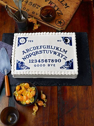 """DIY Spooky Spirit Cake..""""Channeling this professional-looking cake is much simpler than it appears. Just download our free Ouija-board art (courtesy of Hasbro Inc.), then upload it to cakeart.us. The folks there will turn it into an 8""""W x 10""""L sheet of edible wafer paper—for just $4.75"""".. bake the cake and add the edible wafer paper!!! how cool is this?!"""