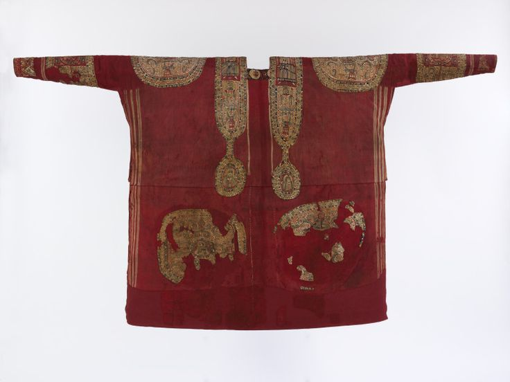 ~ Tunic. Place of origin: Egypt Date: A.D. 670-870 Medium: Plain woven wool, with appliqué ornaments tapestry-woven in coloured wool and linen on linen wraps.