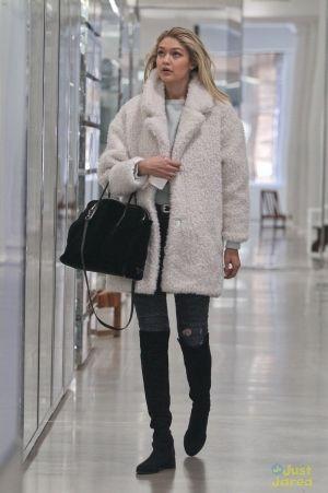 Gigi Hadid wearing Lovers + Friends Aaron Moto Skinny Jeans, Gerard Darel Cristabelle Coat and Stuart Weitzman 5050 Boots