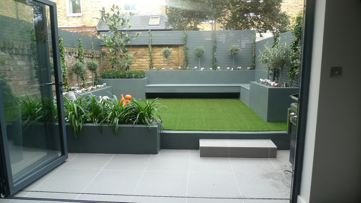 modern small low maintenance garden fake grass grey raised beds contemporary planting docklands london