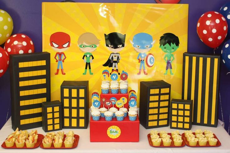 Superheroes birthday party dessert table and backdrop! See more party planning ideas at CatchMyParty.com!