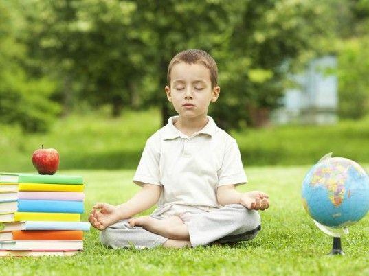 Meditating boy