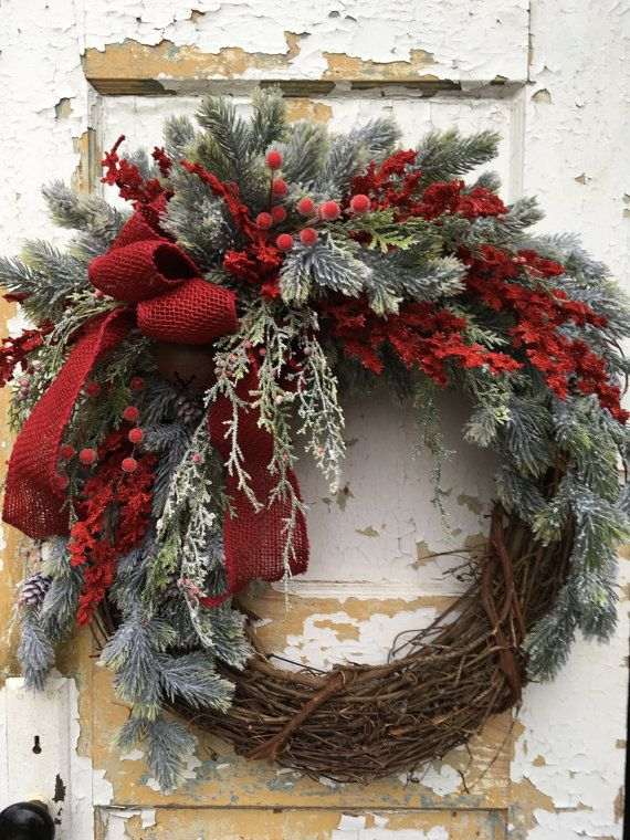 Rustic Christmas Wreath, Holiday Wreath, Christmas Front Door Wreath, Christmas Decor  This sparkling festive Christmas wreath will greet your guests with warmth and good cheer. It is filled with snow covered evergreen boughs, red berries, red accents, pine cones,a rustic Christmas bell and a bright red burlap bow.  The finished size, from tip to tip, is approximately 21 x 23 x 10.  Thank you for visiting my shop!  To view the rest of my items, visit…