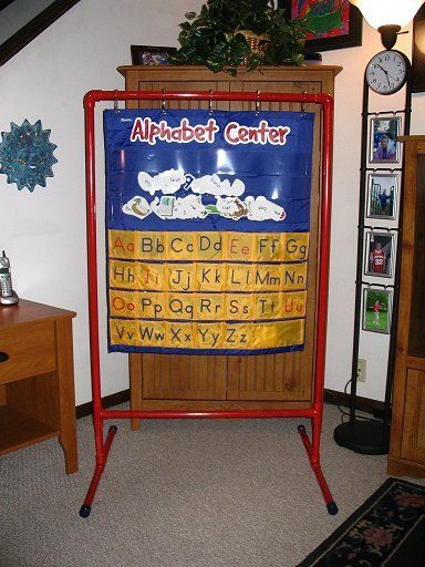 OCD for Kinders: PVC Pocket Chart Holder, includes instruction on how to make a smaller PVC pocket chart holder for target pocket charts.