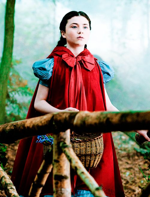 into the woods 2014 film  oversized bow and hooded cape blue dress with child like puff sleeves
