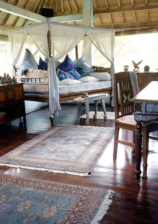 This beautiful collection of Indonesian  furniture and the Bali Style space is divine! Carolyn Tyler home -Traditional Home®