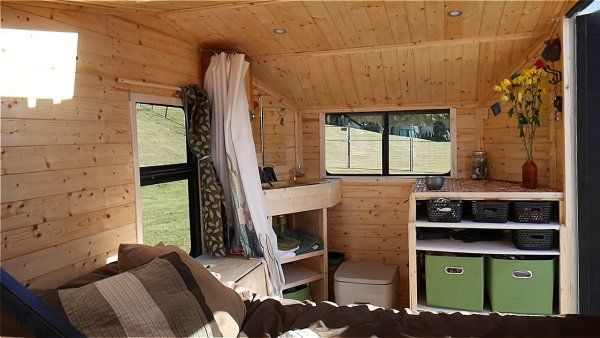 Living Full Time In A 54 Sq Ft Tiny House That Expands To 120 Sq Ft Tiny House Interior Tiny House Living Room Tiny House Loft