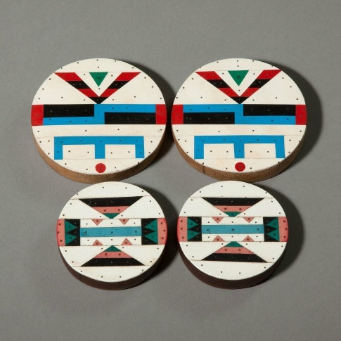 Africa | Zulu Ear Plugs - South Africa.  ca. 1930 - 1940. These were most likely made in Johannesburg by craftsmen who sold them to migrant workers as gifts for their wives.  | They are made of soft wood with finely worked vinyl mosaic overlays. | At an early age, a Zulu child's earlobes were pierced and gradually stretched to allow for larger and larger ear plugs to be worn.