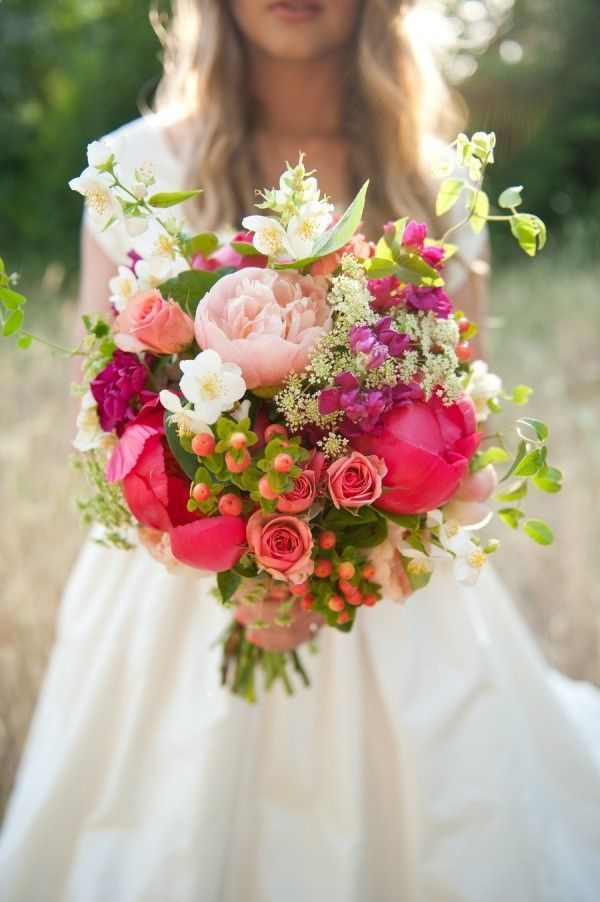 Fuchsia and blush Peonies, roses, wildflowers berries - the perfect Spring wedding bouquet! Bohemian Wedding Style -- Pinspiration by Frosted Events @frostedevents #wedding #boho