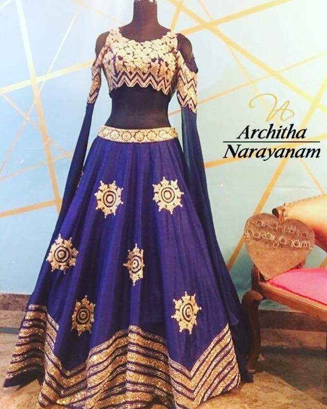 Beautiful blue color lehenga and blouse with cold shoulder. 22 October 2017