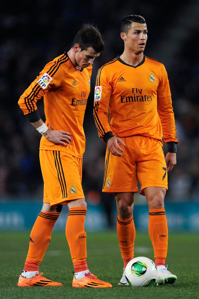 Gareth Bale and Cristiano Ronaldo stand next to the ball before a free-kick during the Copa del Rey quarter final first leg match between RCD Espanyol and Real Madrid CF at Cornellà-El Prat Stadium on January 21, 2014 in Barcelona, Spain.