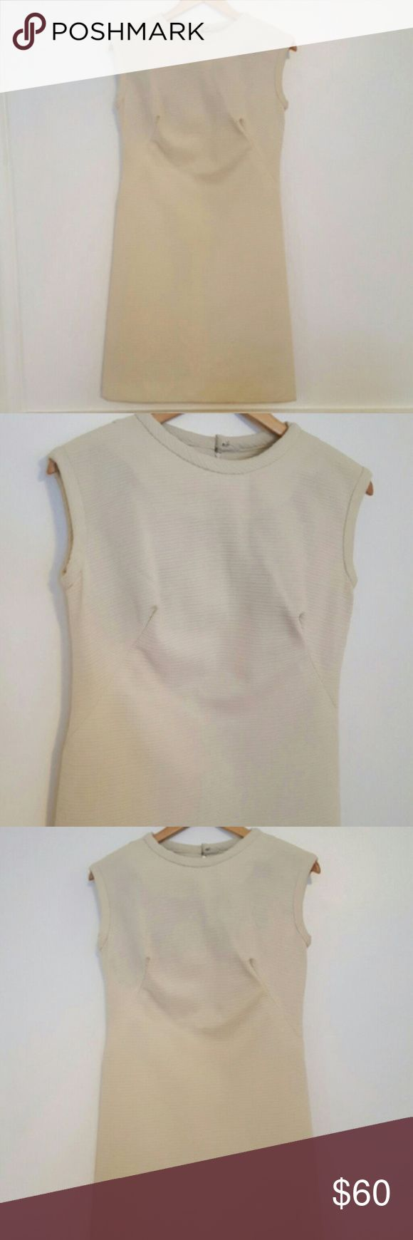 """1960s Mod Shift Cream Textured Sleeveless Dress Great vintage condition cream 60s Parkshire Original shift dress for summer and fall. Perfect with a scarf and heels. Bust is 19.5"""" flat across, waist is 17"""" flat across, and hips are 19.5"""" flat across. 38.5"""" length and the fabric has some stretch. Similar to a modern size medium (not a guarantee of fit- please see measurements). imperfection noted in the last pic. Vintage Dresses Midi"""