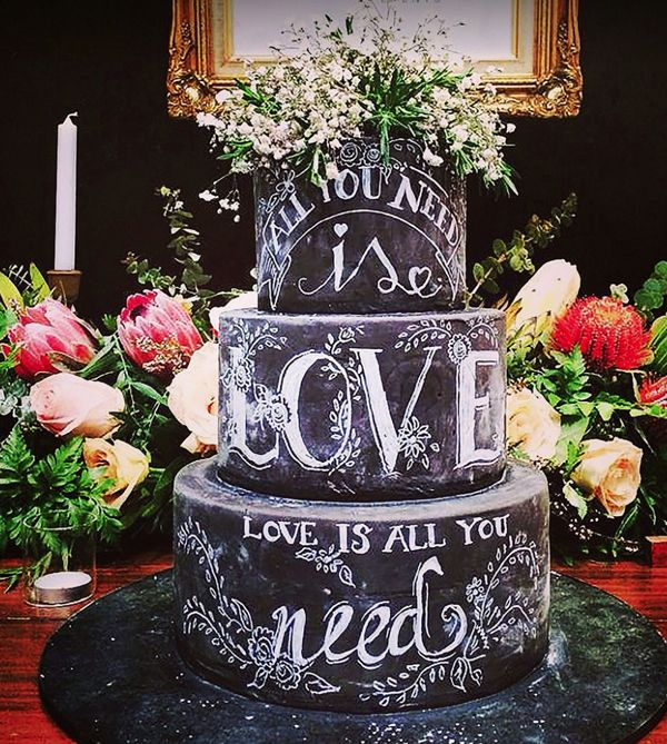 Beatles lyrics, beautiful fonts and a floral topper combine to create a truly jaw-dropping confection.     Photo via  Deliciously Decadent .