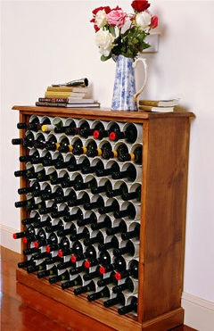 You can store bottles simply and affordably with a rack made from a bookcase and bits of pipe.