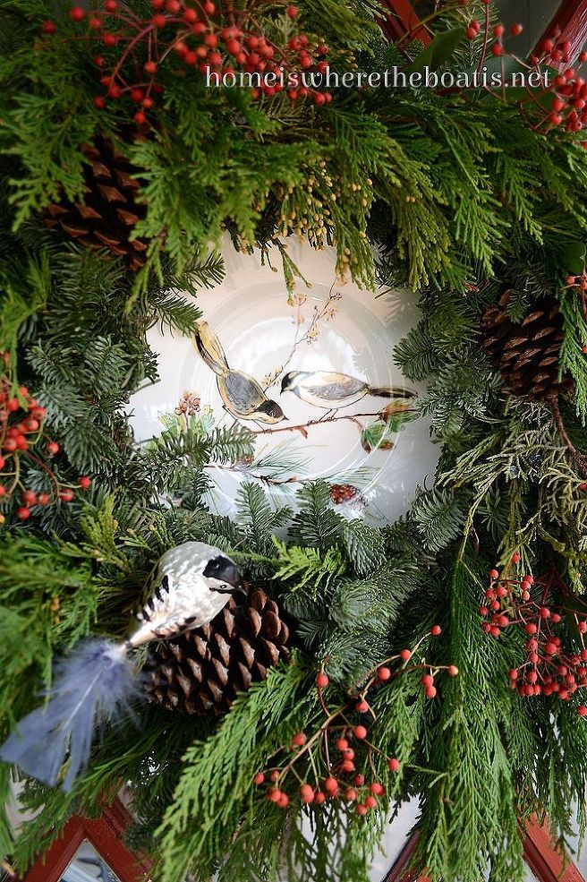 A live wreath needed some additional feathering, so I cut some berries and Leyland Cypress, to add some fullness and frame to plate on the door along with a clip on bird ornament.
