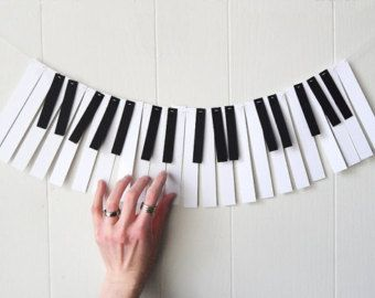 88 Key Mini Piano Paper Garland ➼Great for decorating the house or classroom, podium or desk. ➼Measures approx. 3.25 feet ( Almost 1 metre) with extra string for hanging. ➼Each 100#, white, cotton, card stock key measures 2.5 by .75 . Each Black key is made from recycled, 100#, card stock and measures 1.5 by .5. ➼Hand sewn to white crochet thread, which looks lovely and makes the garland pieces adjustable, so you can move the pieces closer or further apart if you would like to have a…
