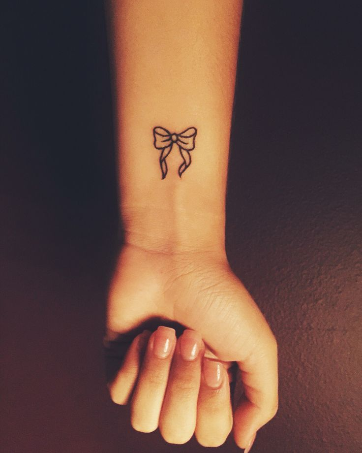 Small bow tattoo- cute wrist tattoo-but maybe somewhere else