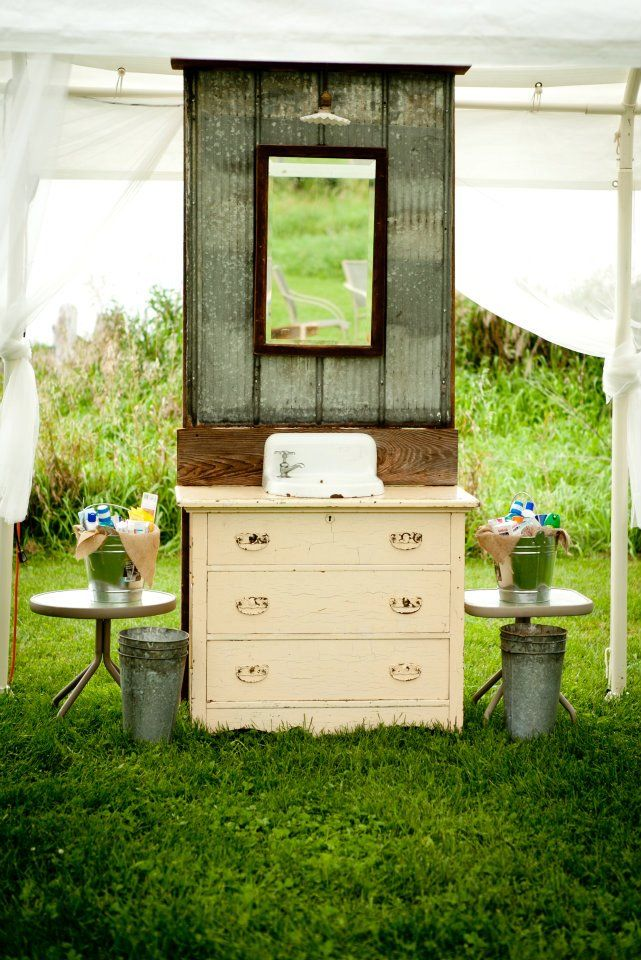 DIY wash stand for bathroom at outdoor wedding.