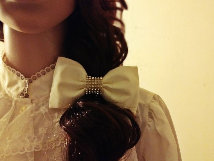 Unisex Wedding Bridal Ivory Glitter Gold Tone Rhinestone Hair Bow or Bow Tie by The Fox Jewelry Boutique at Tictail Unisex Wedding Bridal Ivory Glitter Gold Tone Rhinestone Hair Bow or Bow Tie 1990's Size: About 5 Inches across. String is about 9 InchesColor: Ivory, goldtone and clear glittering rhinestonesWould be a nice hair bow for a flower girl, or could be modified just a bit with a longer band or clip and made into fun bow tie for the groom, usher etc.. Can be worn flat or puffed. Has…