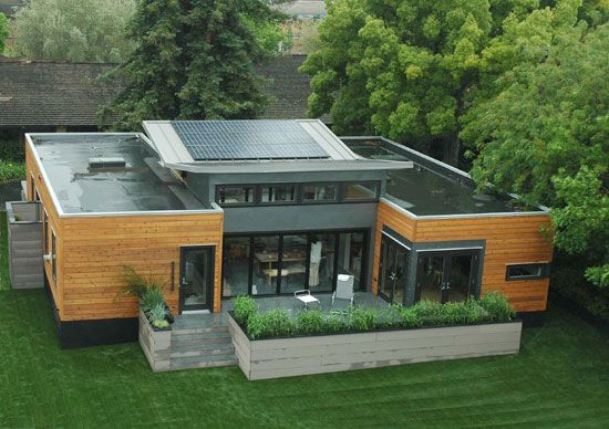 A prefab green building with integrated solar panels from Michelle Kaufmann Designs.