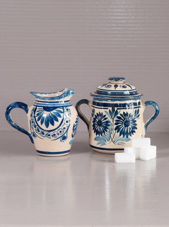 Quimper Pottery Sugar and Cream set. Hand painted pieces, signed HB Quimper with blue daisies decor.