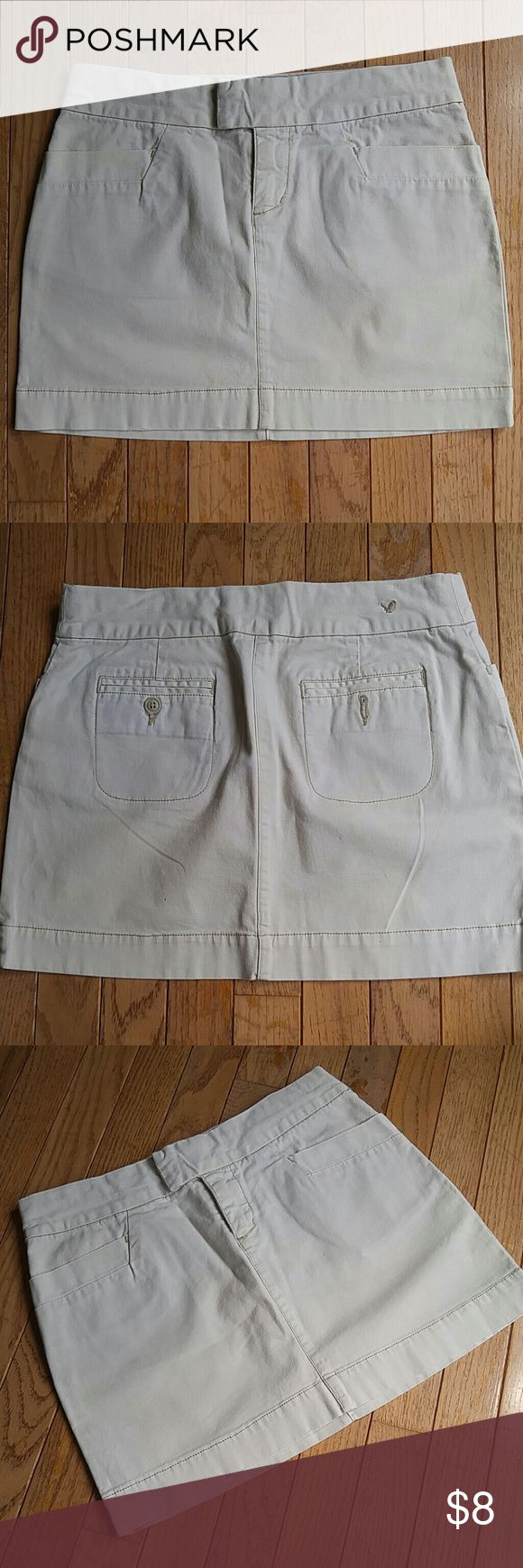 American Eagle Chino Skirt Khaki mini skirt from American Eagle. Size 0. Some marks and wear as pictured, but still lots of life left! American Eagle Outfitters Skirts Mini