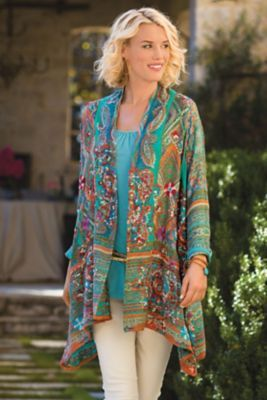 Miravilla Jacket. Vibrant Tunisian patterns and tones are captured in this marvelous woven jacquard jacket, enlivened with vivid hand-embroidered mandalas and flowers in front and contrasting designs at the back, sleeves and border.   Soft Surroundings