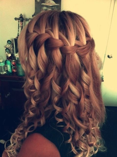 Try this curly waterfall braid style for a romantic look with plenty of impact. Be sure to use heat protection spray on your mid-lengths if you're reaching for the curling iron.Image via Pinterest. From weheartit.com.